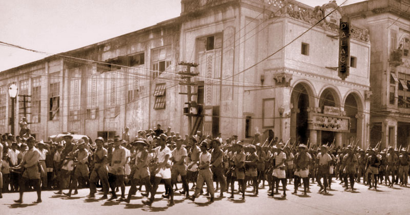 Free Panay Guerilla Forces led by Col. Macario Peralta on parade in Iloilo City Proper during Liberation of Panay, 1945.