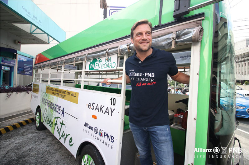 Allianz PNB Life President and Chief Executive Officer Alexander Grenz in one of the seven Allianz PNB Life-branded E-Jeepneys.