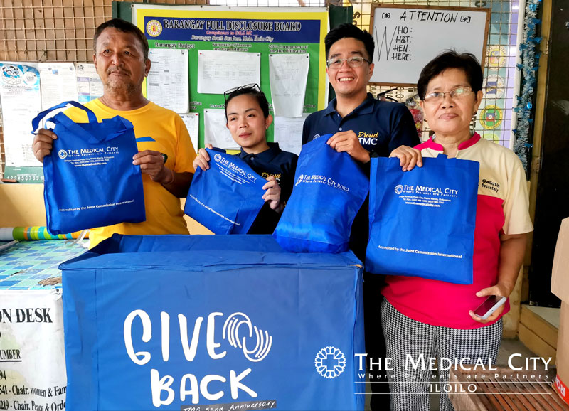 "TMC Iloilo turned over the ""Give Back Box"" to the barangay officials of South San Jose, Molo, Iloilo City that contain clothes and toys donated by TMC Iloilo employees."