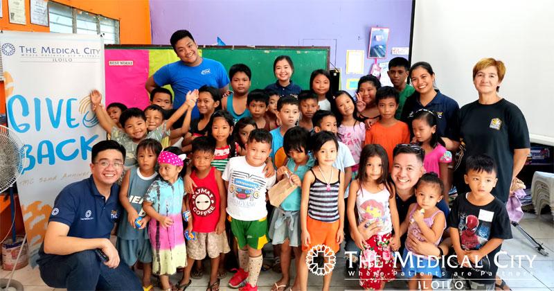 TMC Iloilo team together with the kids of South San Jose, Molo, Iloilo City