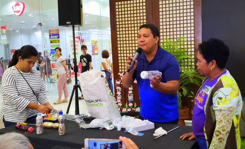 Dann Diez conducts Ecobricks making workshop during the eco-friendly fair at GT Town Center.