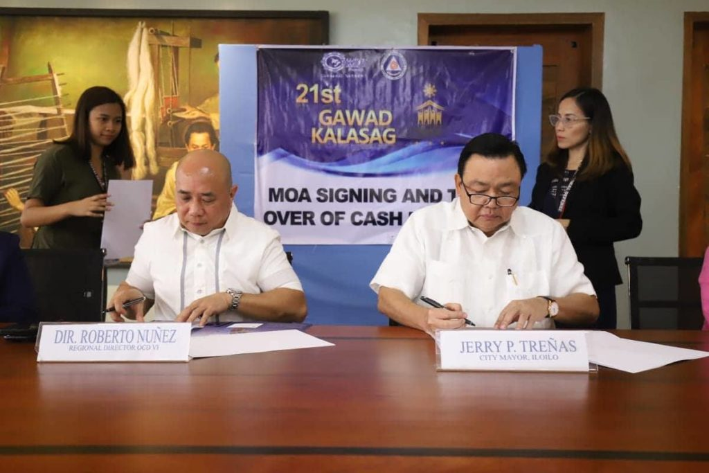 MOA Signing: Dir. Robert Nunez, Regional Director of Office of the Civil Defense 6, and Iloilo City Mayor Jerry Trenas.