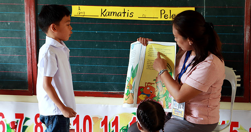 Filipino student reading.