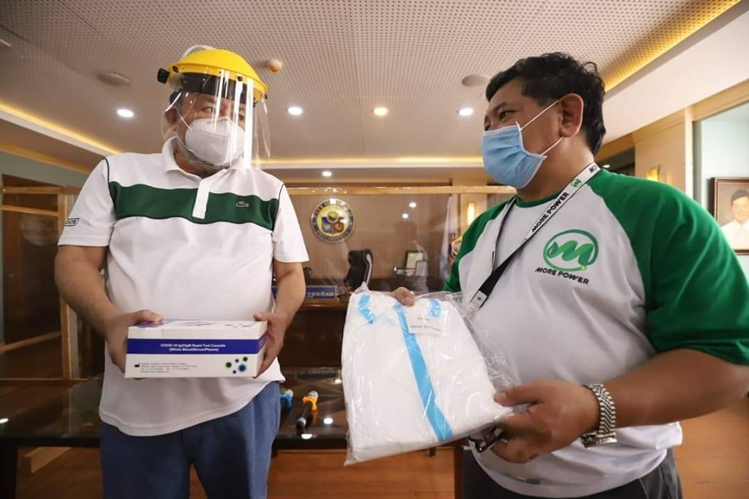 MORE Power President Roel Castro gives COVID-19 rapid test kits, PPEs to Mayor Jerry Trenas.