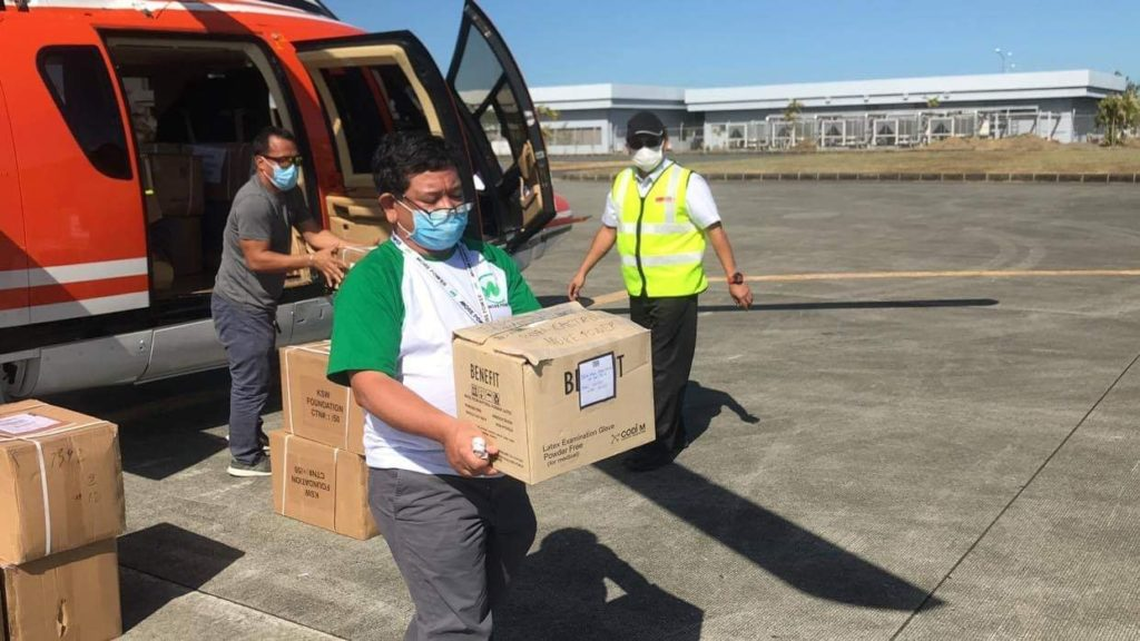 MORE Power President Roel Castro helps in the transport of rapid test kits and PPEs to be donated to Iloilo City.