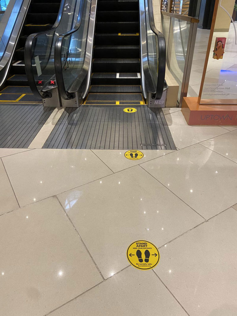 Social distancing markers are placed in escalators and ATM terminals to ensure that mall-goers will be able to observe strict procedures against the spread of COVID-19.