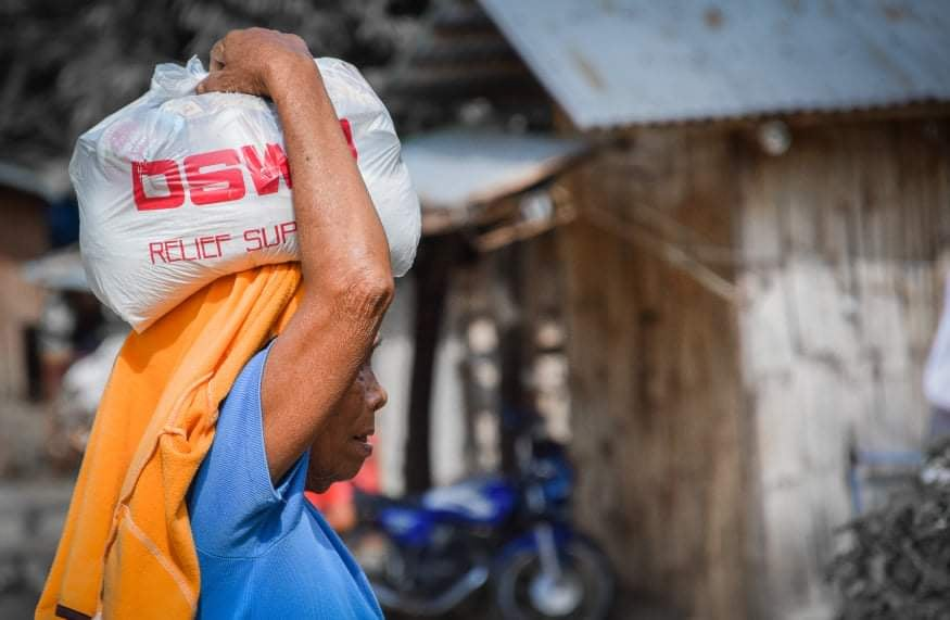 IP member gets share of food packs from DSWD.