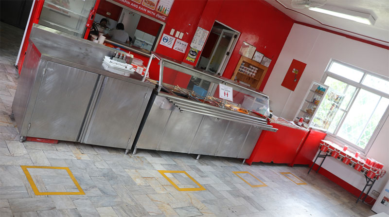 Floor markings have been placed around sites, such as in the canteen of Coca-Cola Iloilo plant seen here, to provide visual cues in order to practice physical distancing.