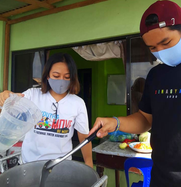 Karito youth volunteers help out by cooking snacks for oil spill cleanup workers.