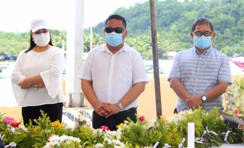 Guimaras officials offer flowers.
