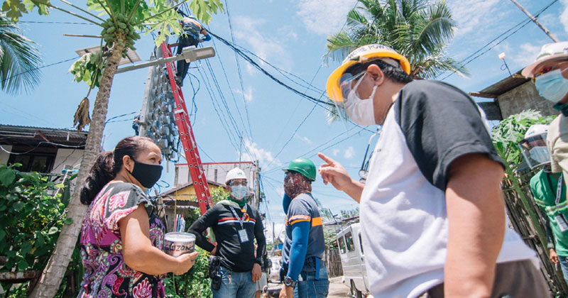 Castro out in the field talking to some MORE Power Iloilo consumers.