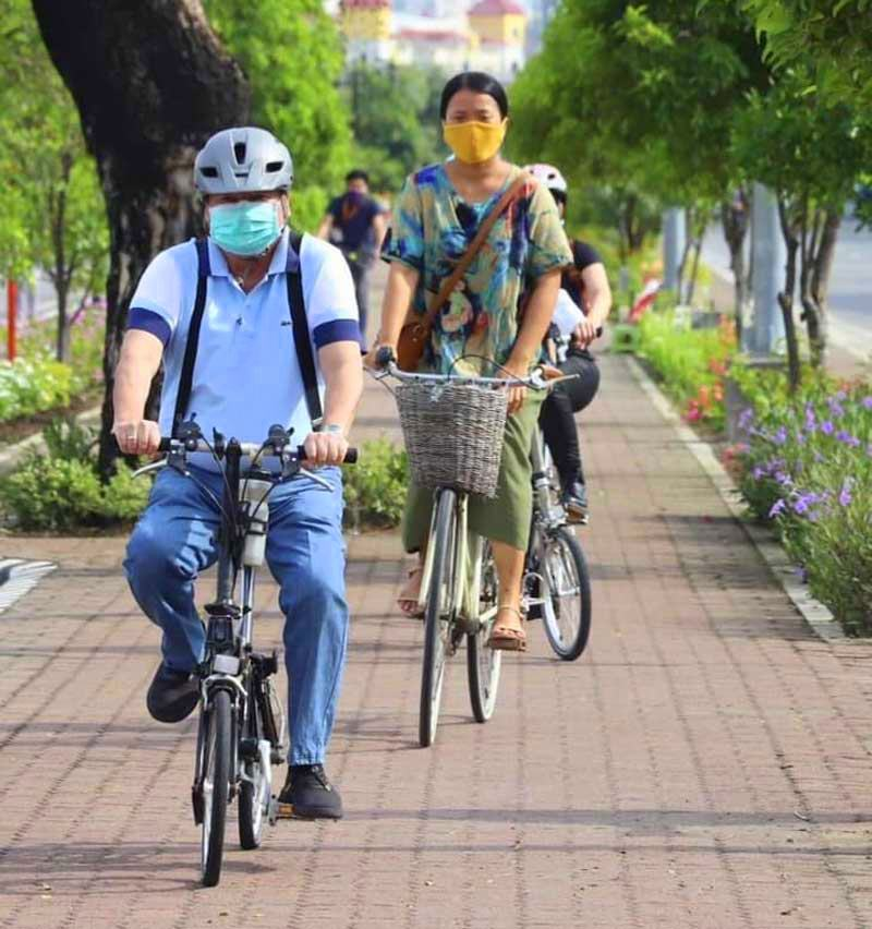 Iloilo City Mayor Jerry Trenas cycles on the protected bike lanes.