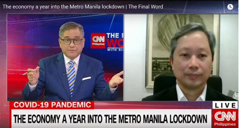"""BDO chief investment officer Frederico Rafael """"Fritz"""" D. Ocampo (right) talks with Rico Hizon of CNN Philippines."""