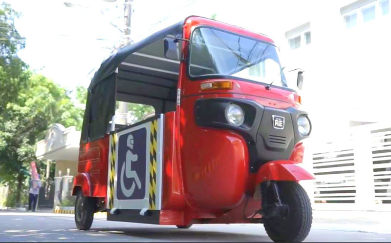 Bajaj RE customized by Pong Ylagan for PWD transport.